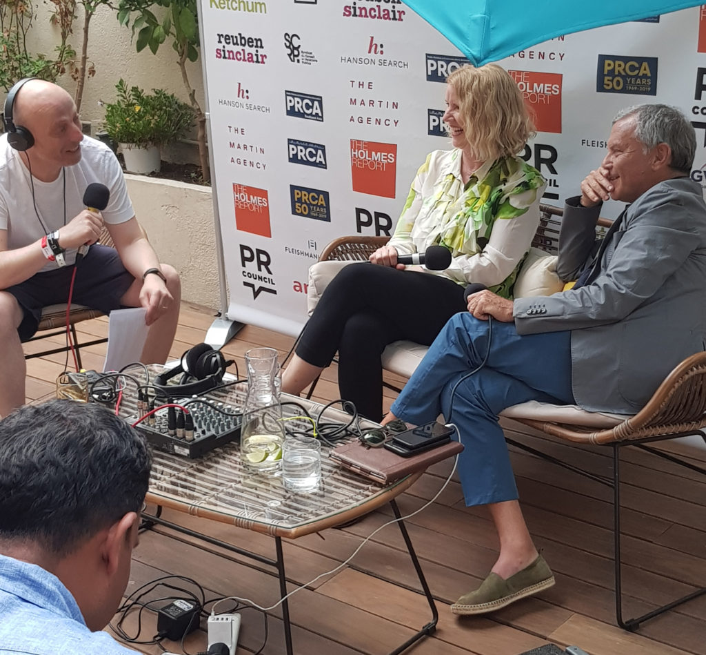 Russell Goldsmith chats to Marian Goodell and Sir Martin Sorrell